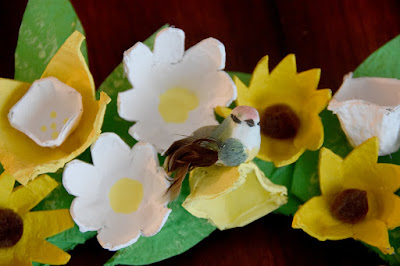 small bird resting on flowers for egg carton wreath