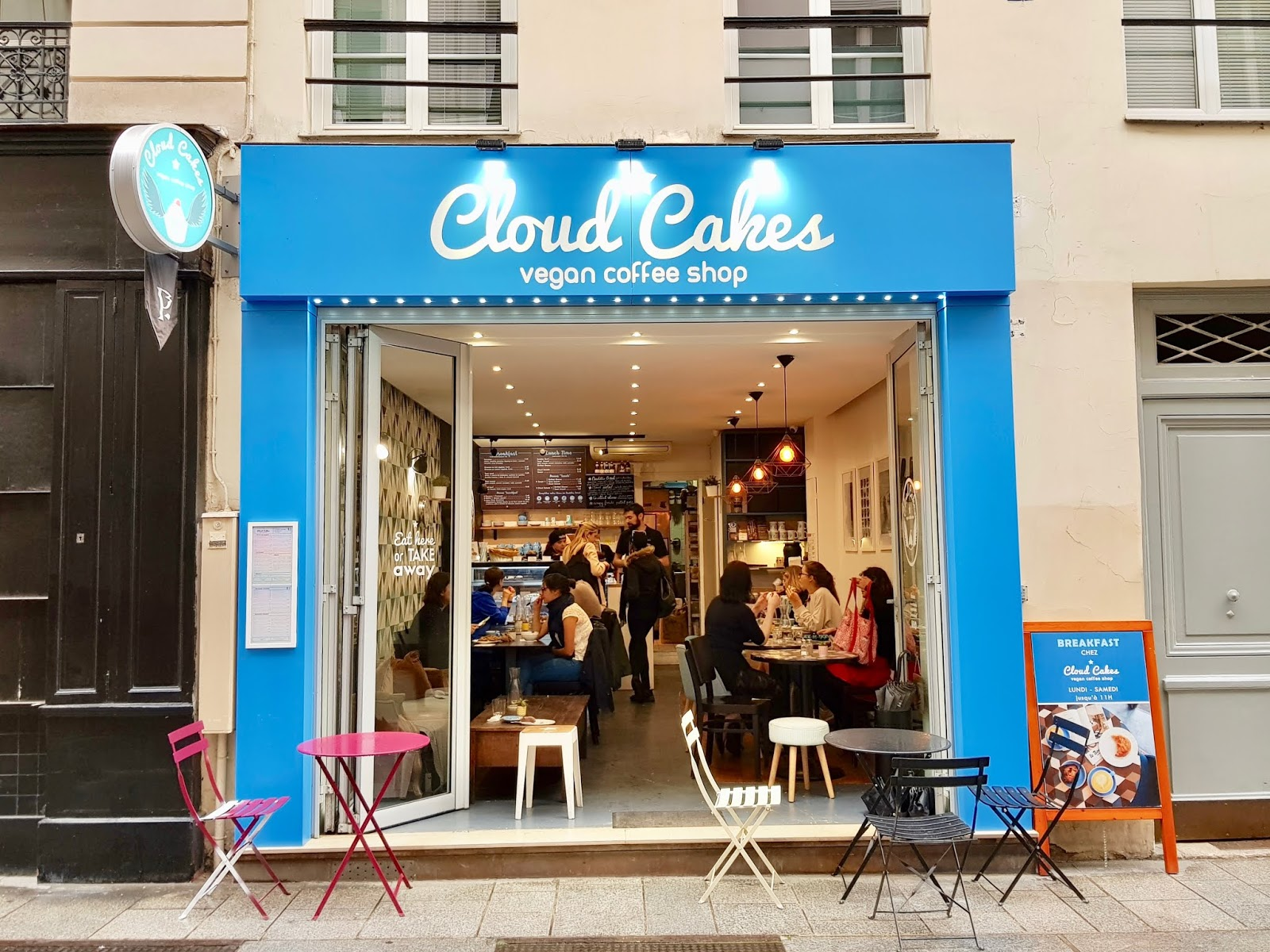 exterior of cloud cakes cafe in Paris, with blue signage