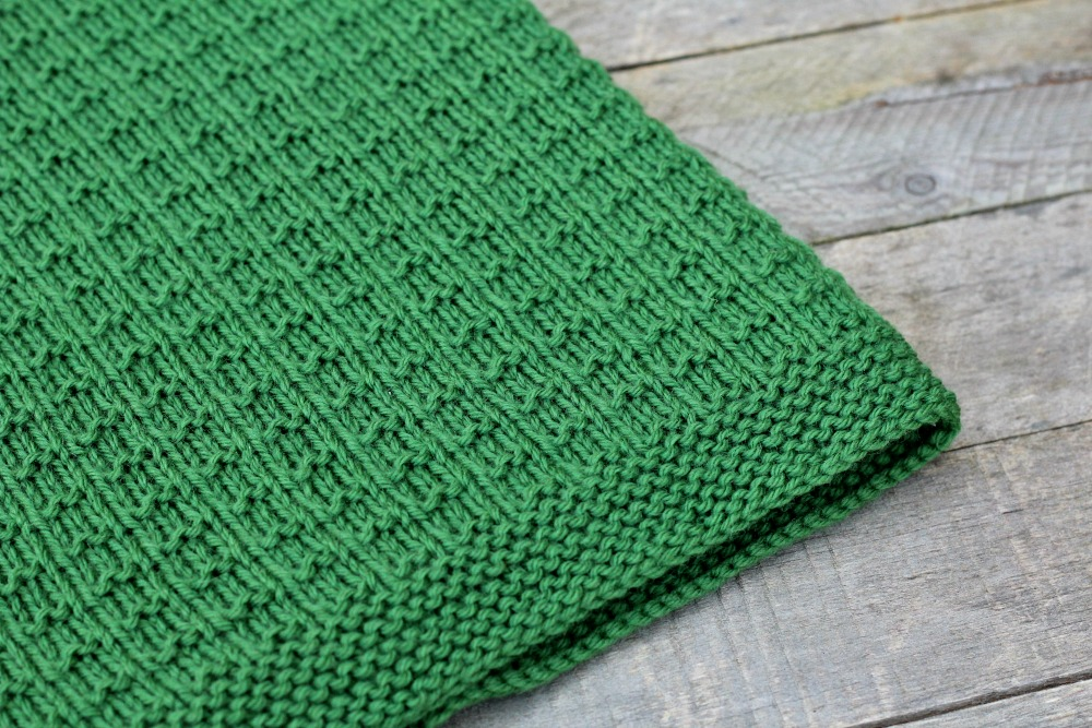 simple knitting pattern using textured knitting stitches in green worsted weight yarn