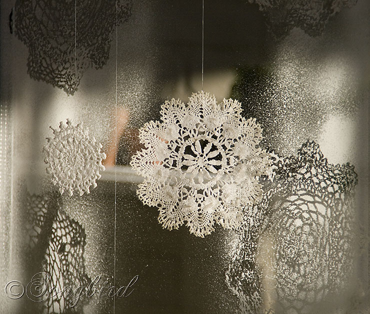 Faux Ice Flowers On The Windows Made With Doilies And