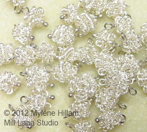 Stash of crazy wire beads made from silver wire