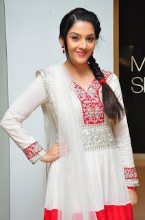 Actress Mehreen Pictures in White Salwar Kameez at Krishna Gadi Veera Prema Gaadha Movie Promotion 0021