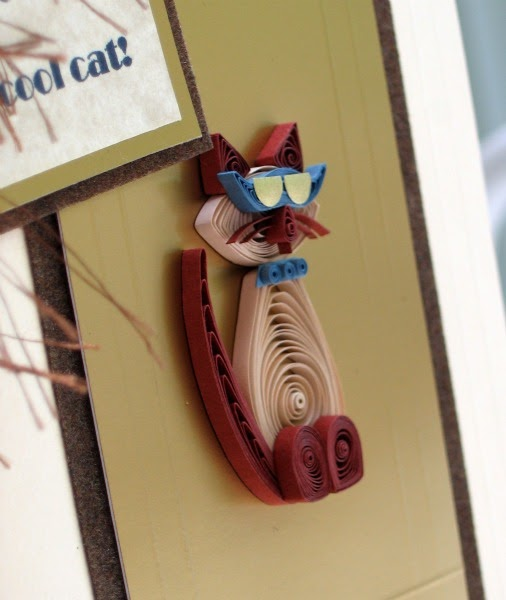 close-up of quilled cat wearing sunglasses on greeting card