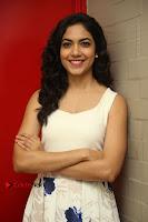 Actress Ritu Varma Stills in White Floral Short Dress at Kesava Movie Success Meet .COM 0095.JPG