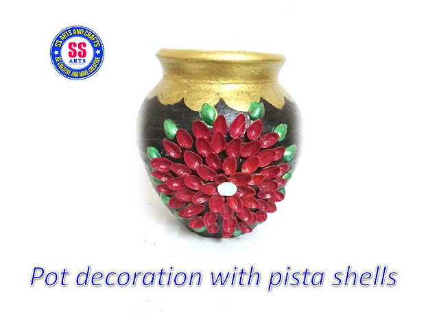 hERE IS PISTA SHELL CRAFTS,PISTA FAIRY HOUSE,PISTA SHAELL PHOTO FRAME,pista shell show piece,pista shell wall hanging,pista shell pot decorations,pista flowers,pista shell peacock,how to make pot decoration with pista shell