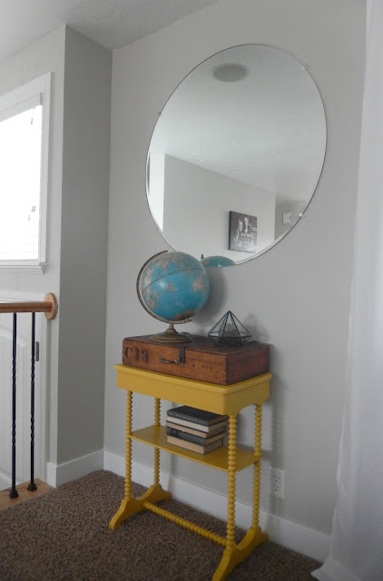 Thrifting Post No. 2: Round mirror, globe, table, wooden box, and old books