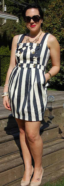 Vertical striped dress and White French Riviera Chanel Flap bag