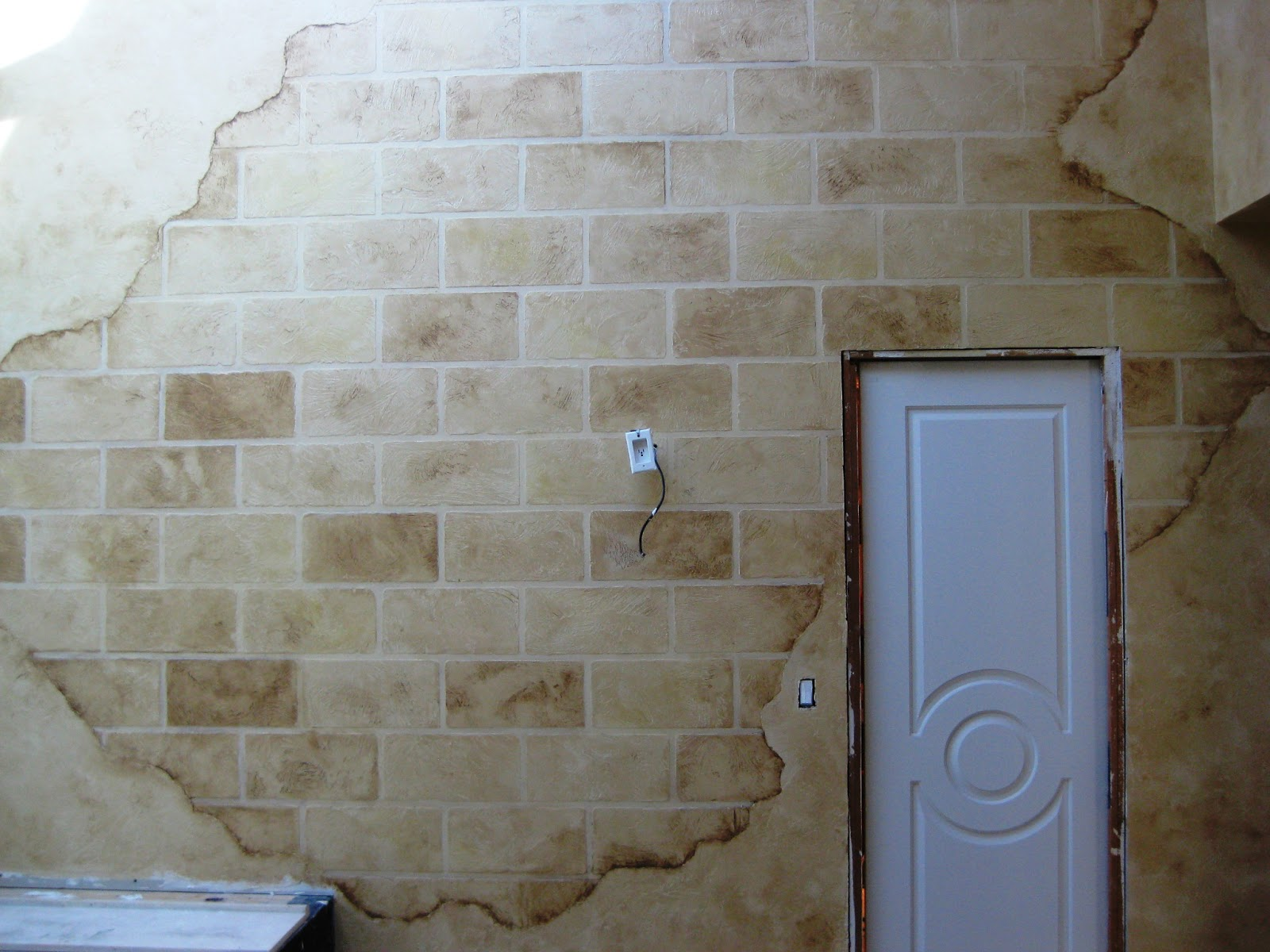 Array of color inc: Distressed faux block wall