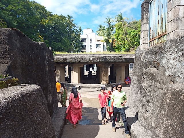 Path between two rock walls leading to Pataleshwar Temple