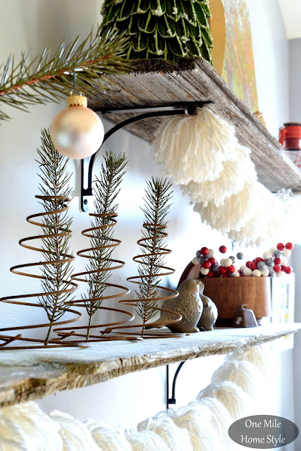 Evergreen Sprigs and Rusty Springs Shelf Decor with White Yarn Pom Pom Garland | Christmas Home Tour - One Mile Home Style