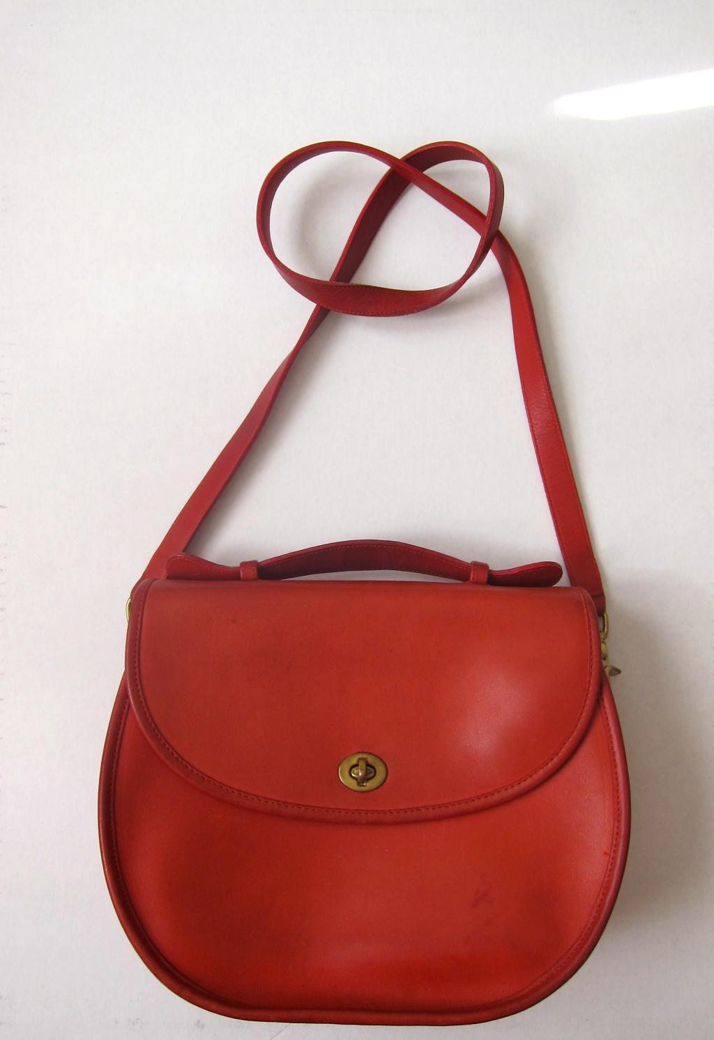 1ab499256bdd laws of general economy  Vintage Coach Saddle Bag
