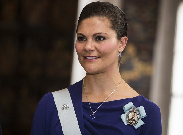 Crown Princess Victoria wore ESCADA Dress and carried Nancy Gonzalez Silver Metallic Clutch