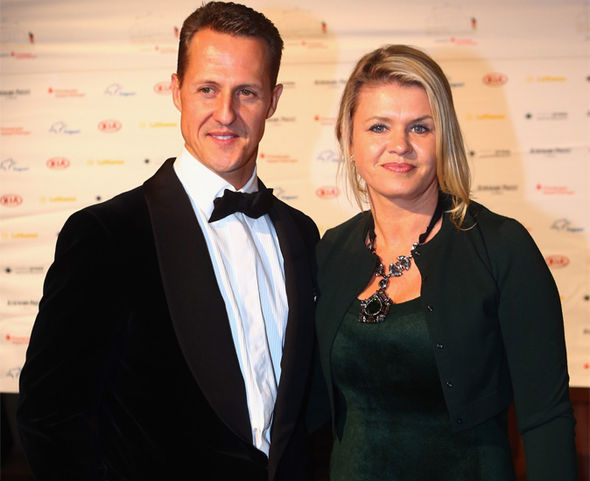Mr Weber wants family life Corinna Schumacher (pictured with Michael) to speak out