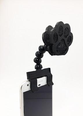 Flexy Paws attaches to any phone, tablet, and most cases