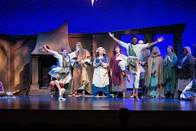 IN REVIEW: the cast of Greensboro Opera's December 2019 production of Gian Carlo Menotti's AMAHL AND THE NIGHT VISITORS, with dancers CHELSEA HILDING and D. JEROME WELLS in the foreground [Photograph by VanderVeen Photographers, © by Greensboro Opera]