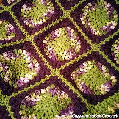 Large Granny Square with a Circle in the middle.