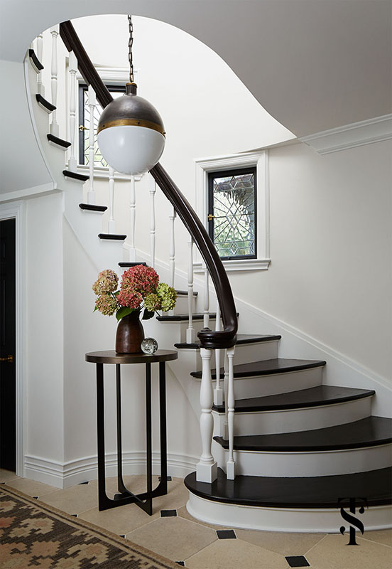 Stairway with sculptural architectural detail and Classic Decor in French Tudor Renovation by Summer Thornton on Hello Lovely