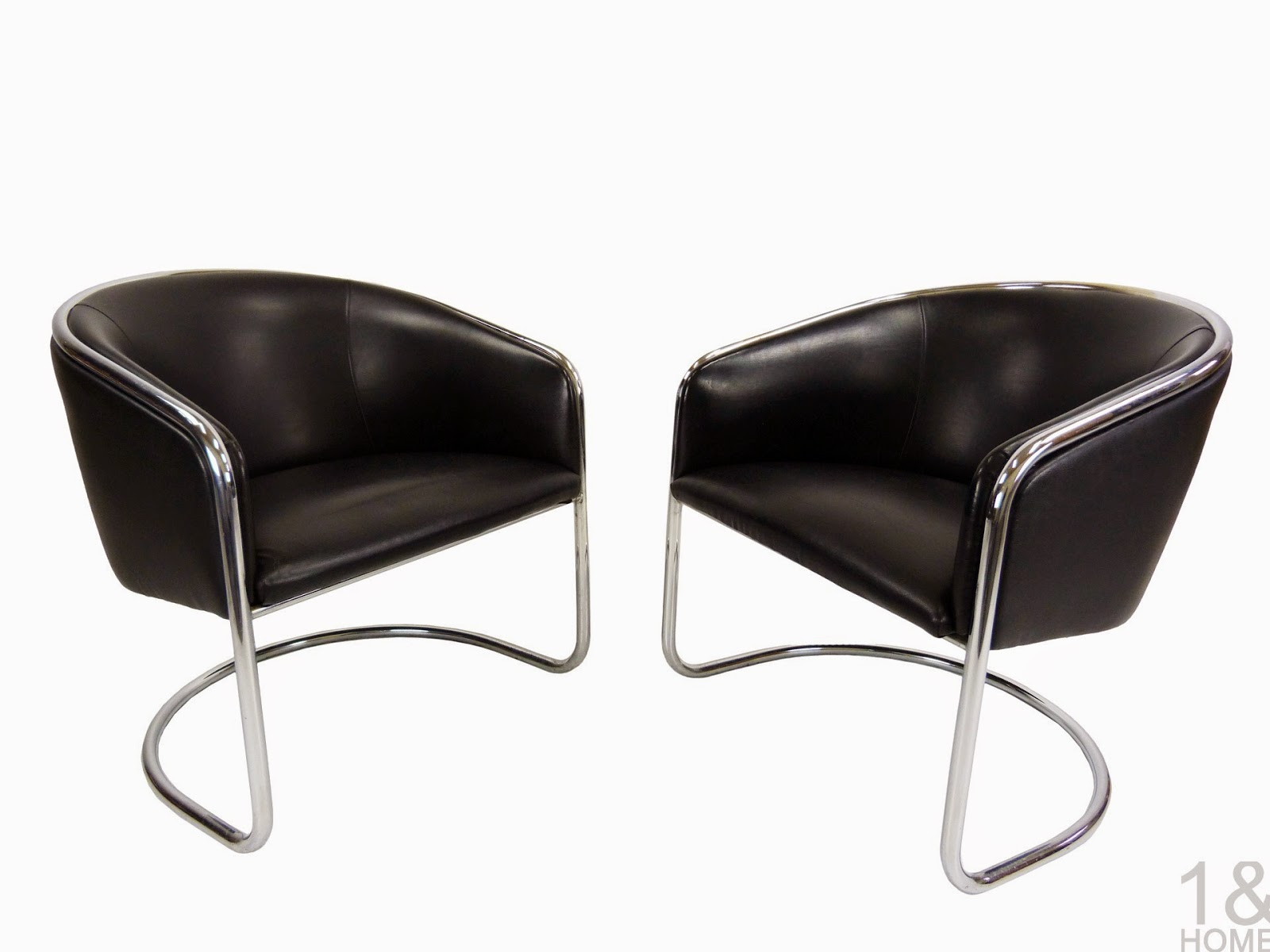 mid-century black leather chrome cantilever barrel back club chairs Thonet