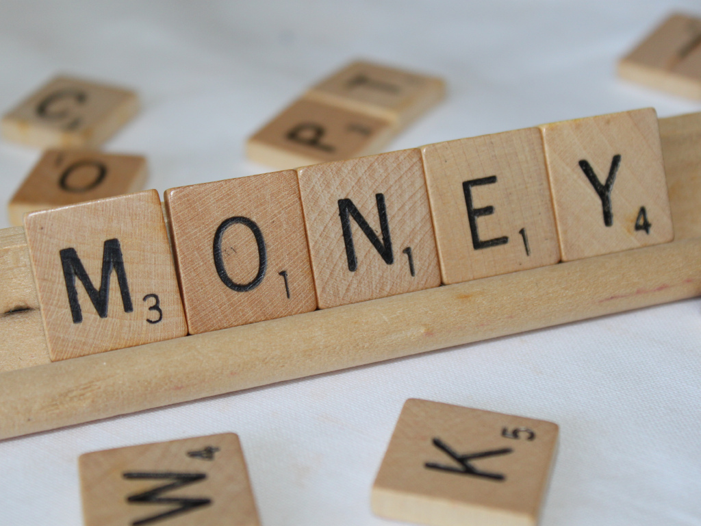 money spelled out in scrabble letters