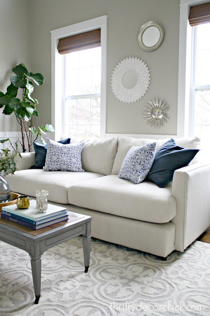 light sofa with blue pillows