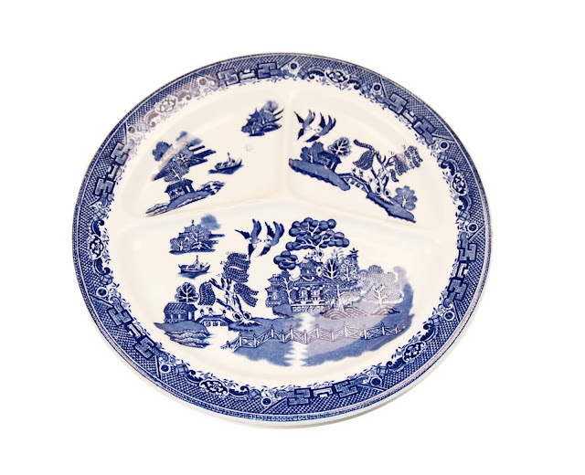 A Blue Willow plate divided with three separate sections.
