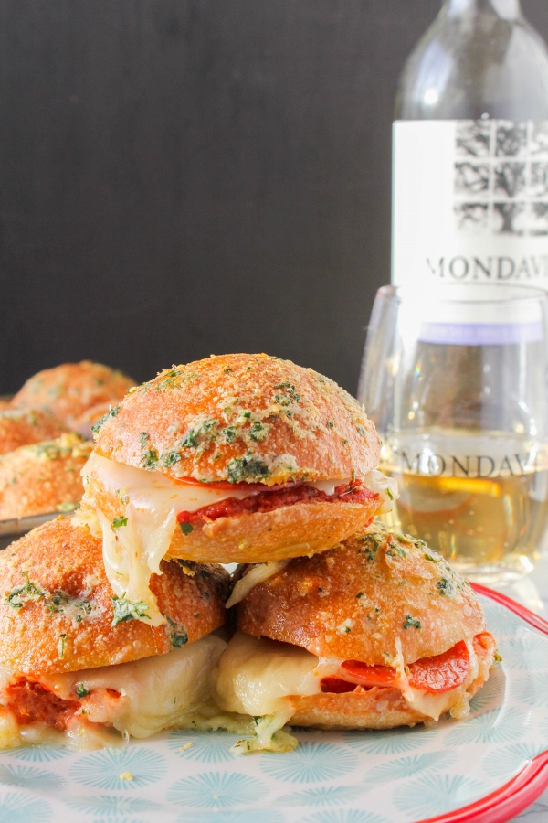 Easy, cheesy and over the top delicious, these Baked Pepperoni Pizza Sliders will be the hit of your next get together or party!