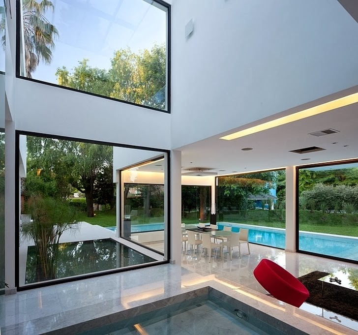 Glass walls in Minimalist Casa Carrara by Andres Remy Architects