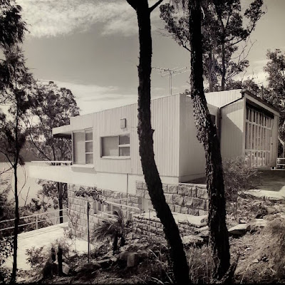 Photo of a mid-century modern house on display at The Moderns exhibition.