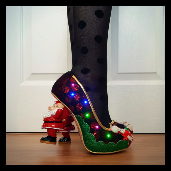 Christmas flashing light up shoes on feet with Santa character heels