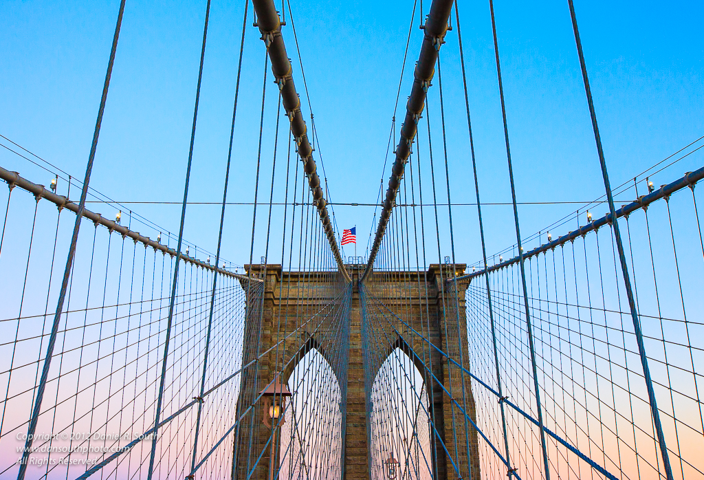 a photo of the brooklyn bridge at sunset