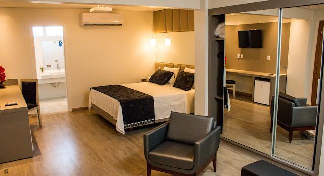 Quartos do Ity Hotel com ar condicionado, tv, frigobar e muito mais...