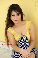 Cute Telugu Actress Shunaya Solanki High Definition Spicy Pos in Yellow Top and Skirt  0335.JPG