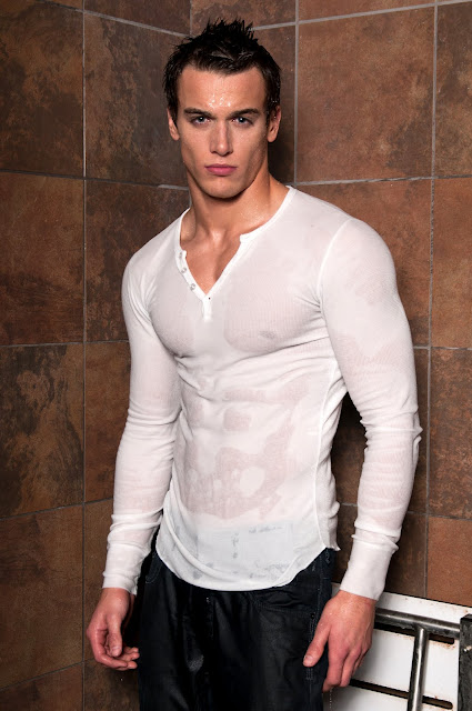 man in wet t-shirt