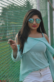 Madhulagna Das looks super cute in White Shorts and Transparent Top 14.JPG