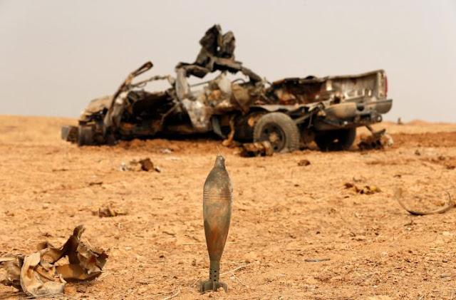 Kendaraan milik pejuang Peshmerga yang hancur di tembak ISIS