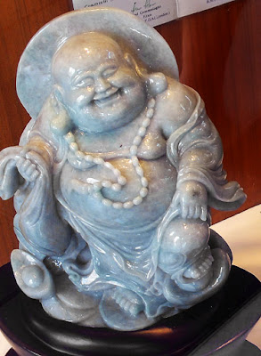 Beautiful White Buddha Statue laughing