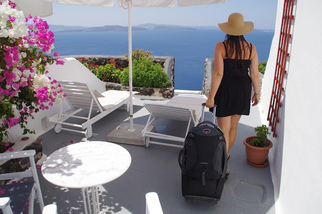 Girl with Osprey Meridian 75 Luggage in Santorini