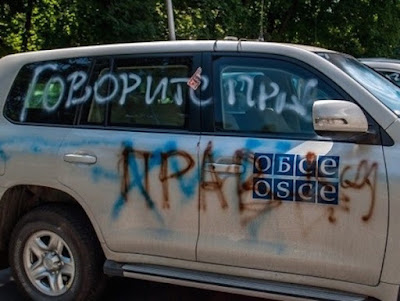 "DPR ""protesters"" damaged OSCE and Red Cross cars"