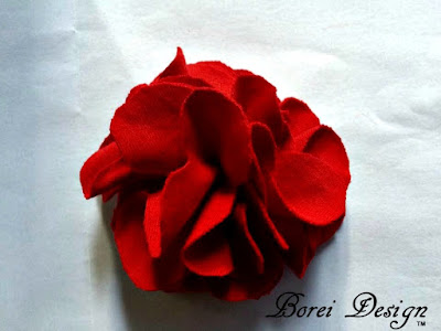 DIY tutorial on how to make a flower embellishment using scrap tshirt fabric.