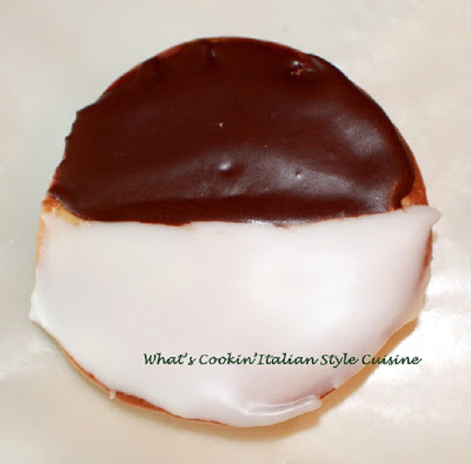 These are called half moon cookies.  this is more a black and white as the frosting is smooth. The cookies are frosted half white and half chocolate frosting. . These are famous in Utica New York bakeries and a local cookie there.