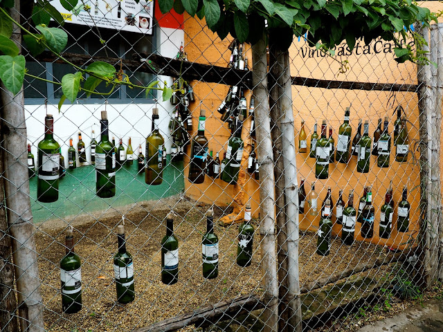 Wine bottle artwork on the streets of San Pedro, Lake Atitlan, Guatemala