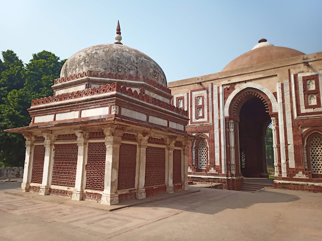 Domed mosque building with adjacent domed structure in Qutub complex, Delhi