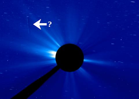 UFO Or Probe Caught Near The Sun?