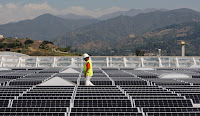 Solar panels cover the roof of a Sam's Club in Glendora, Calif. (Photograph Credit: David McNew — Getty Images) Click to Enlarge.