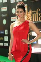 Meenakshi Dixit in Red One Shoulder Red Zipped up gown at IIFA Utsavam Award 43.JPG