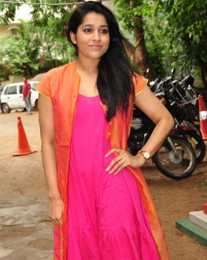 Indian TV Anchor Rashmi Gautam Long Hair Hot Looking Face Stills In Orange Dress