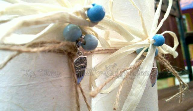 La TEI , perline azzurre e ciondolo ala argento