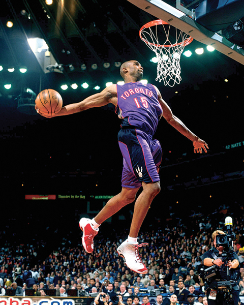 Vince Carter conducts a windmill dunk that helped him win the 2000 NBA Slam Dunk Contest on February 12, 2000.