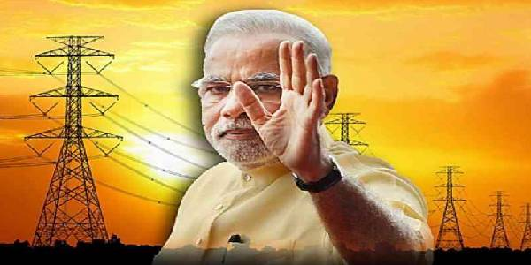 Mr. Narendra Modi waving his left hand, background showing electrical transformers.