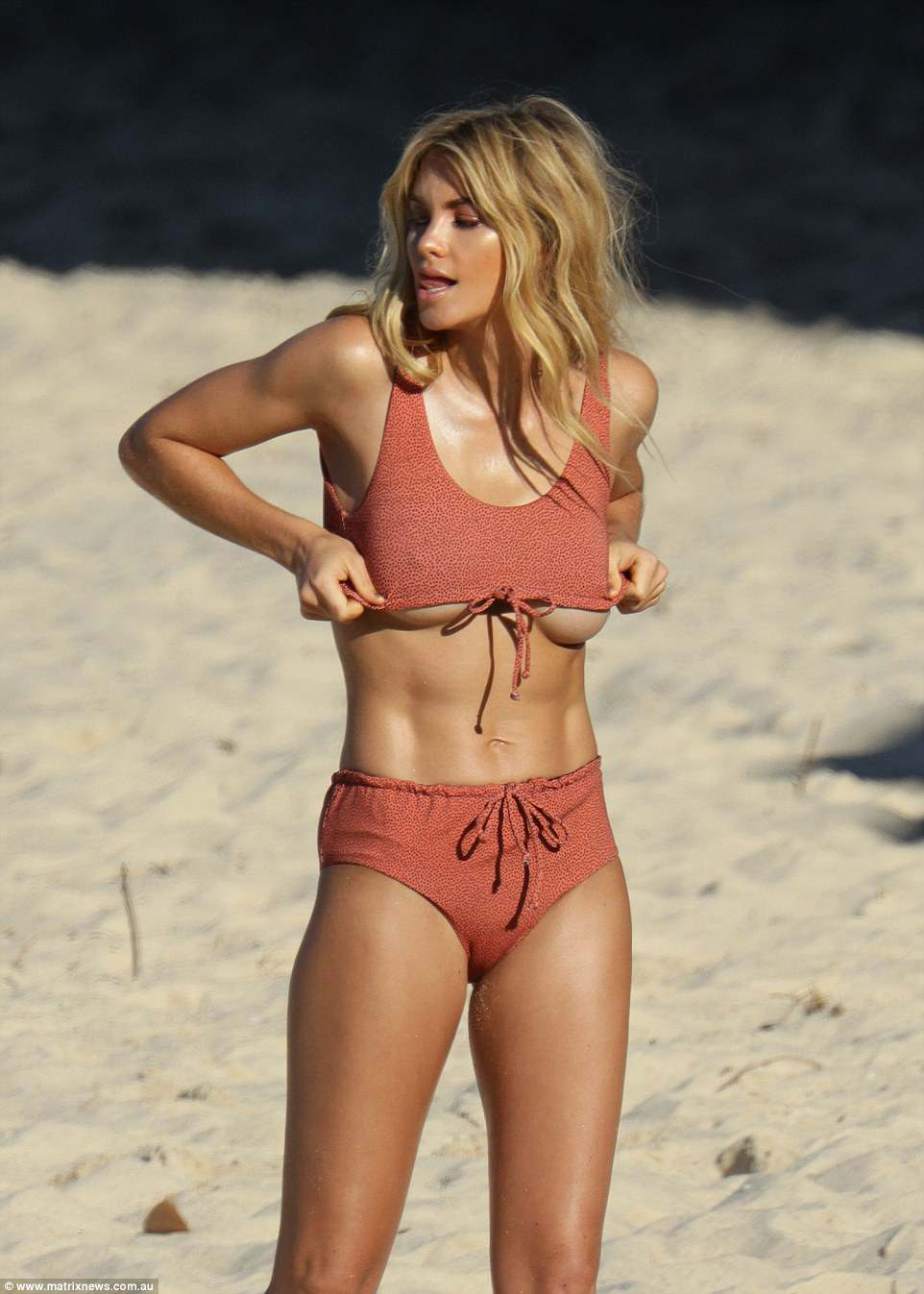 Elyse Taylor bares underboob during beach shoot